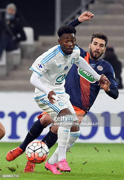 Marseille's French midfielder GeorgesKevin Nkoudou challenges Montpellier's French defender Mathieu Deplagne during the French Cup round of 16...