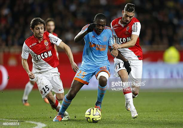 Marseille's French midfielder Giannelli Imbula vies with Monaco's Portuguese midfielder Silva Bernardo and Monaco's Belgian midfielder Yannick...