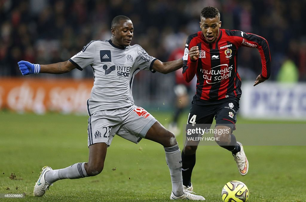 Marseille's French midfielder <a gi-track='captionPersonalityLinkClicked' href=/galleries/search?phrase=Giannelli+Imbula&family=editorial&specificpeople=11355911 ng-click='$event.stopPropagation()'>Giannelli Imbula</a> (L) vies with Nice's French forward Alassane Plea (R) during the French L1 football match between Nice (OGCN) and Marseille (OM) on Januay 23, 2015 at the Allianz Riviera stadium in Nice, southeastern France.