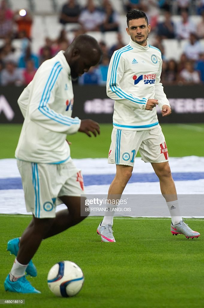 Marseille's French midfielder Lassana Diarra (L) and Marseille's French midfielder Remy Cabella practice prior to the French L1 football match Olympique de Marseille vs Troyes on August 23, 2015 at the Velodrome stadium in Marseille, southern France.