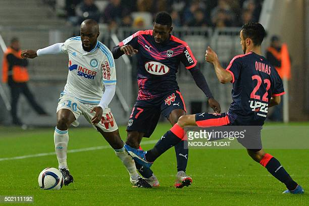 Marseille's French midfielder Lassana Diarra vies with Bordeaux's Andre Poko and Adam Ounas during the French L1 football match between Bordeaux and...