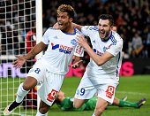 Marseille's French midfielder Mario Lemina celebrates after scoring with Marseille's French forward AndrePierre Gignac during the French L1 football...