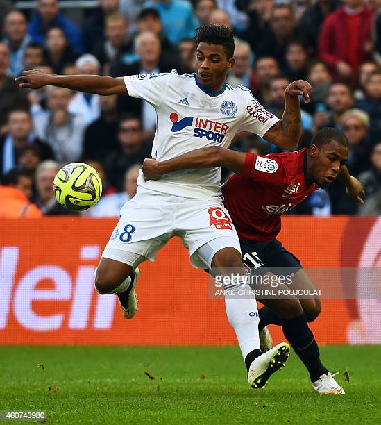 Marseille's French midfielder Mario Lemina vies for the ball with Lille's French defender Djibril Sidibe during the French L1 football match...