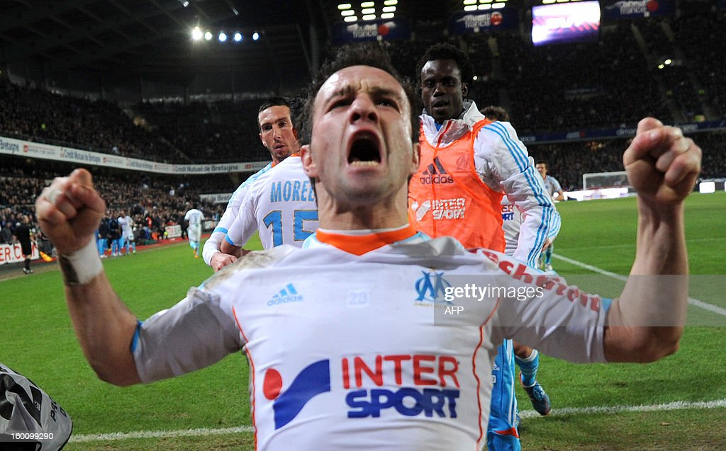Marseille's French midfielder Mathieu Valbuena reacts after his teammate Ghanaian midfielder Andre Ayew scores a goal during the French L1 football match Stade Rennais FC vs. Marseille, on January 26, 2013 at the route de Lorient stadium in Rennes, western France.
