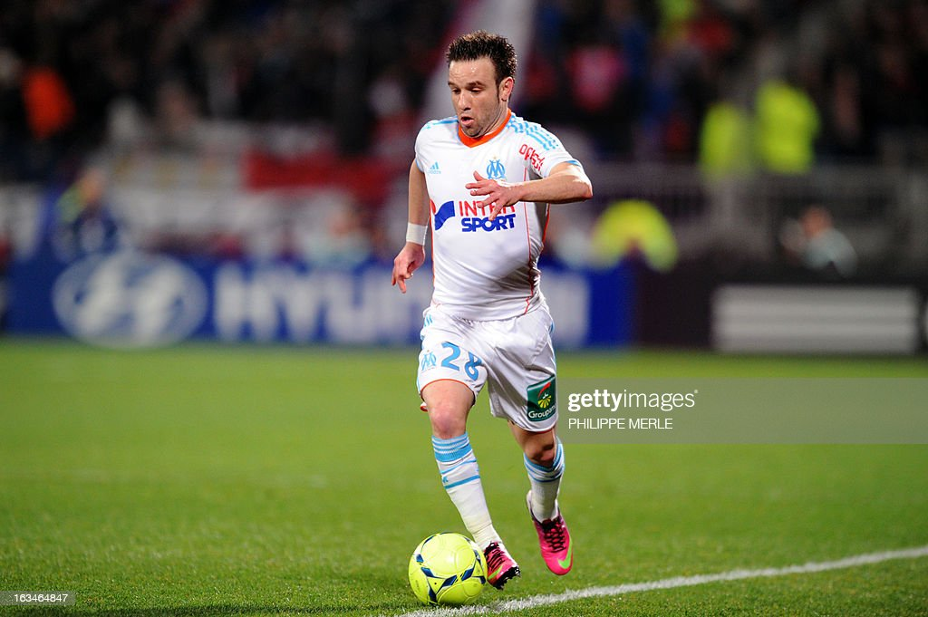 Marseille's French midfielder Mathieu Valbuena runs with the ball during the French L1 football match Olympique Lyonnais (OL) vs Olympique de Marseille (OM) on March 10 , 2013 at the Gerland stadium in Lyon. MERLE
