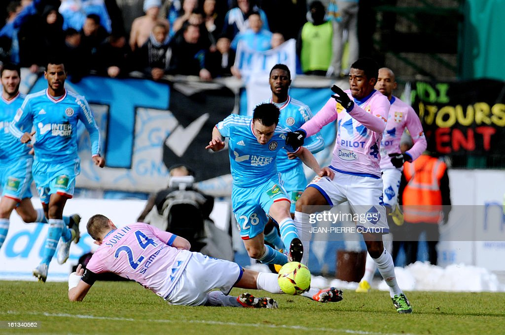 Marseille's French midfielder Mathieu Valbuena (C) vies with Evian's French midfielder Olivier Sorlin (L, bottom) and Evian's Brazilian defender Betao (R) during the French L1 football match Evian (ETGFC) vs Marseille (OM) on February 10, 2013 at the city stadium Parc des sports in Annecy, eastern France. AFP PHOTO / JEAN-PIERRE CLATOT