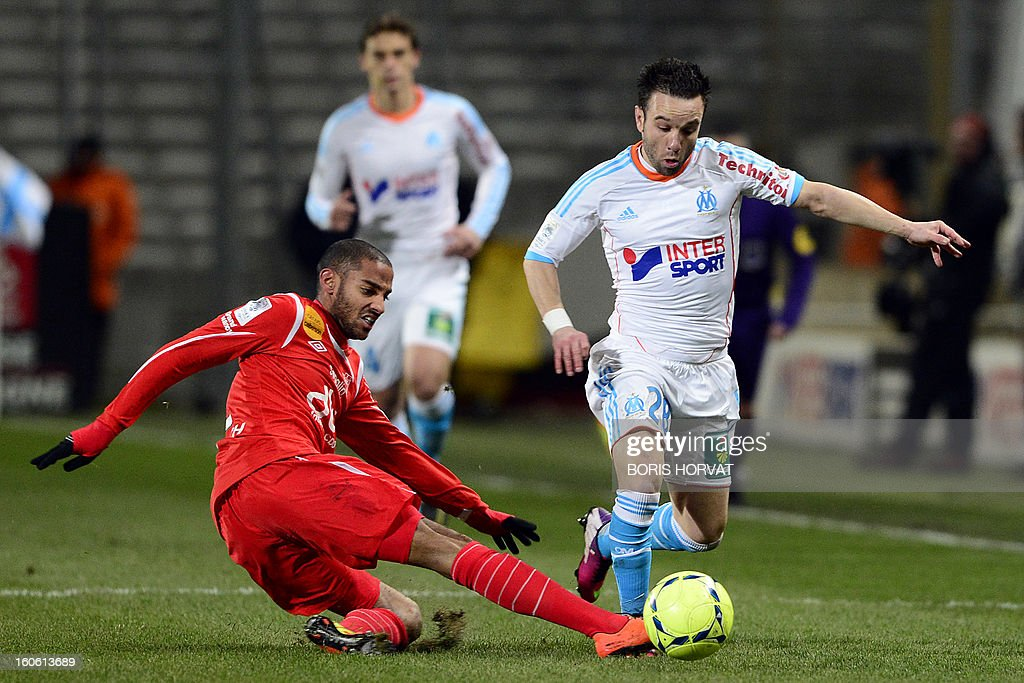 Marseille's French midfielder Mathieu Valbuena (R) vies with Nancy's French defender Yassine Jebbour (L) during their French L1 football match Olympique de Marseille (OM) versus Nancy (ASNL) at the Velodrome stadium in Marseille, on February 3, 2013.