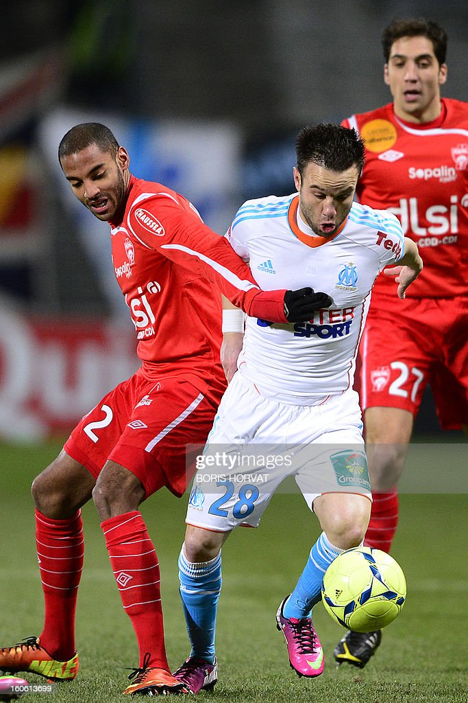 Marseille's French midfielder Mathieu Valbuena (R) vies with Nancy's French defender Yassine Jebbour (L) during their French L1 football match Olympique of Marseille (OM) versus Nancy (ASNL) at the Velodrome stadium in Marseille, on February 03, 2013. AFP PHOTO / BORIS HORVAT