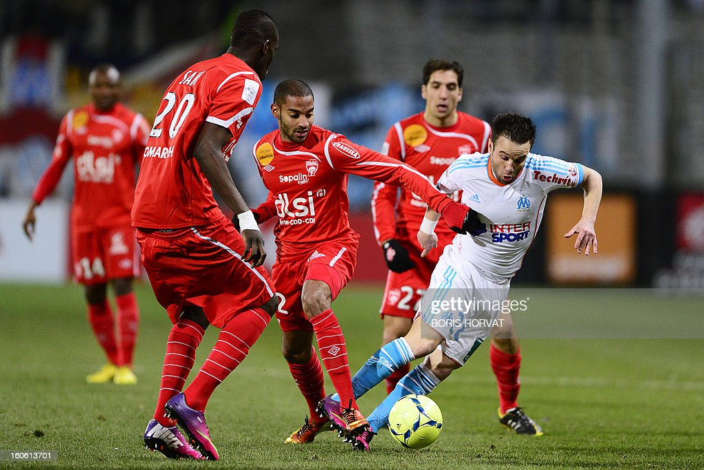 Marseille's French midfielder Mathieu Valbuena (R) vies with Nancy's French defender Yassine Jebbour (C) during their French L1 football match Olympique of Marseille (OM) versus Nancy (ASNL) at the Velodrome stadium in Marseille, on February 03, 2013.