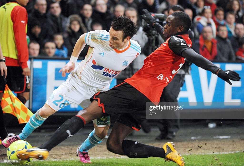 Marseille's French midfielder Mathieu Valbuena (L) vies with Rennes' French Congolese defender Chris Mavinga (R) during the French L1 football match Stade Rennais FC vs Marseille, on January 26, 2013 at the route de Lorient stadium in Rennes, western France.