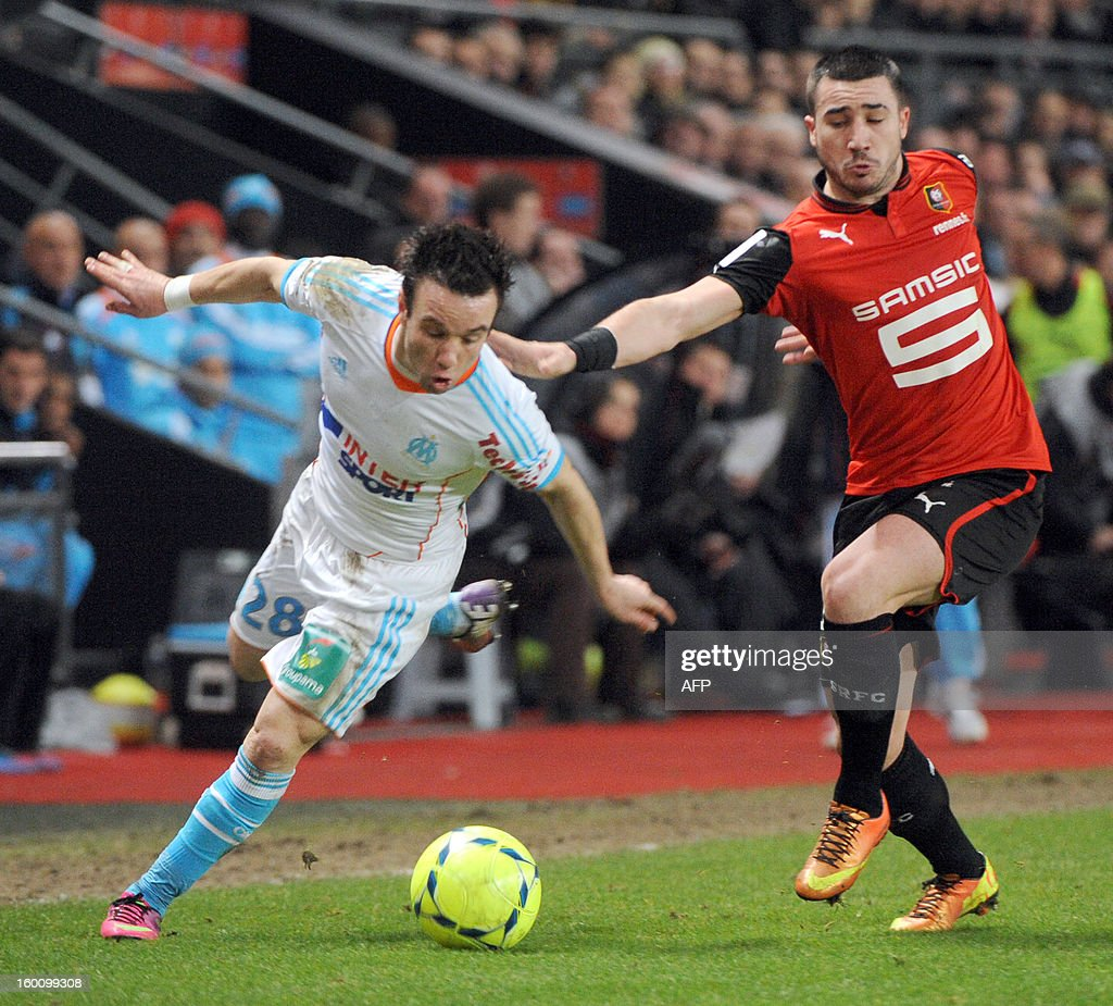 Marseille's French midfielder Mathieu Valbuena (L) vies with Rennes' French midfielder Romain Alessandrini during the French L1 football match Stade Rennais FC vs. Marseille, on January 26, 2013 at the route de Lorient stadium in Rennes, western France.