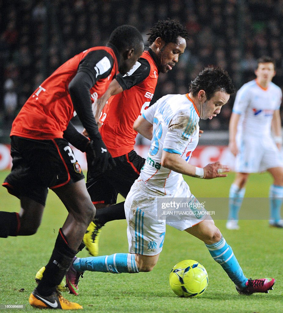 Marseille's French midfielder Mathieu Valbuena vies with Rennes' French Congolese defender Chris Mavinga and Rennes' French midfielder Jean II Makoun during their French L1 football match Stade Rennais FC versus Marseille, on January 26, 2013 at the Route de Lorient Stadium in Rennes, western France.