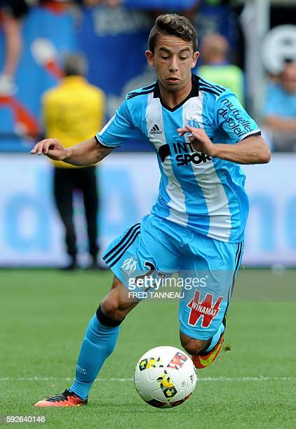 Marseille's French midfielder Maxime Lopez runs with the ball during the French L1 football match between Guingamp and Marseille on August 21 2016 at...