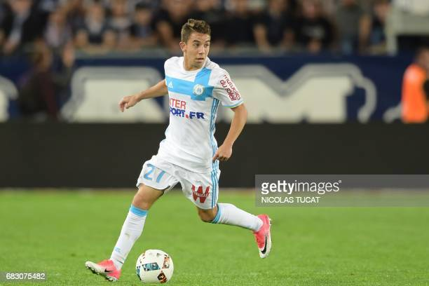 Marseille's French midfielder Maxime Lopez runs with the ball during the French L1 football match between Bordeaux and Marseille on May 14 2017 at...
