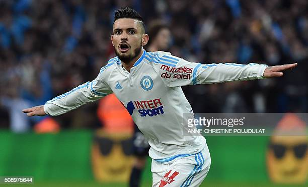 Marseille's French midfielder Remy Cabella celebrates after scoring a goal during the French L1 football match between Marseille and...