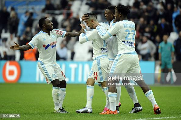 Marseille's French midfielder Remy Cabella celebrates with his teammates after scoring a goal during the French L1 football match Olympique de...