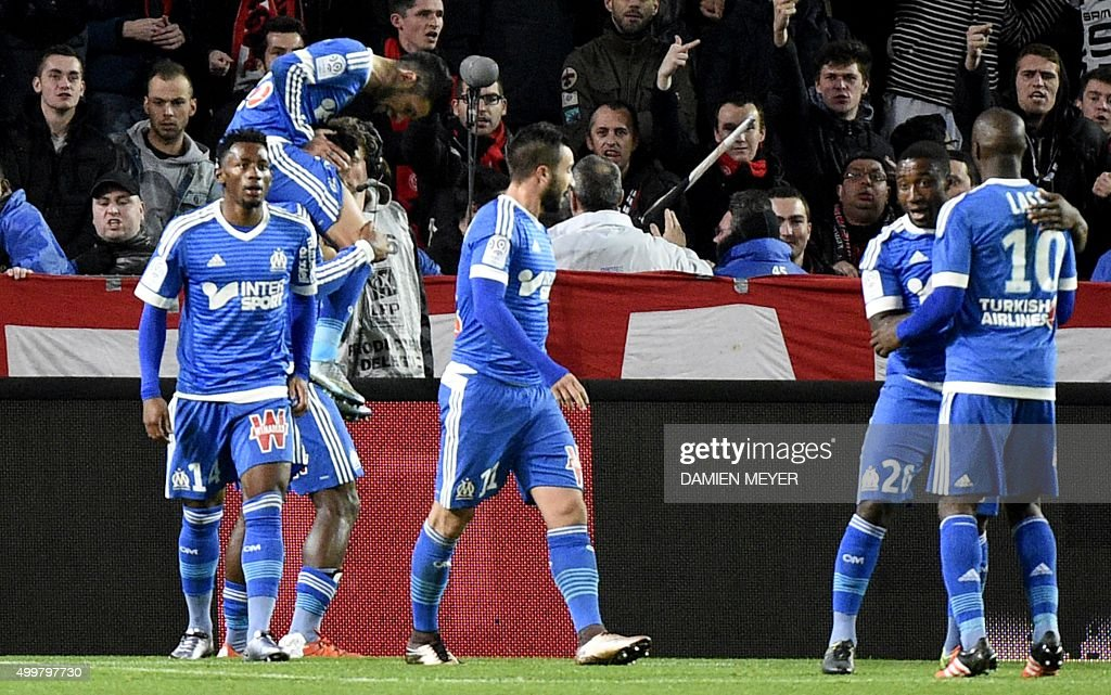 Marseille's French midfielder Remy Cabella celebrates with teammates after scoring a goal during the French L1 football match Rennes against...