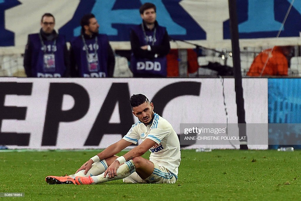 Marseille's French midfielder Remy Cabella reacts at the end of the French L1 football match between Marseille and Paris-Saint-Germain on February 7, 2015 at the Velodrome stadium in Marseille, southern France. AFP PHOTO / ANNE-CHRISTINE POUJOULAT / AFP / ANNE-CHRISTINE POUJOULAT