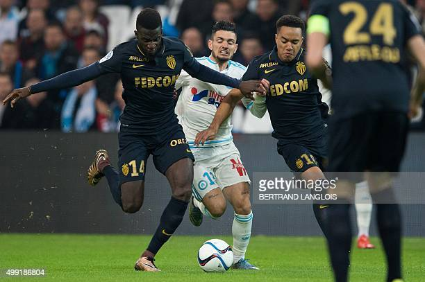 Marseille's French midfielder Remy Cabella vies with Monaco's French Midfielder Tiemoue Bakayoko during the French L1 football match Olympique de...