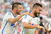Marseille's French midfielder Romain Alessandrini and Marseille's French forward AndrePierre Gignac celebrate after Alessandrini scored his team's...