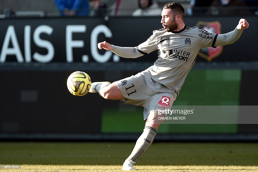 Marseille's French midfielder <a gi-track='captionPersonalityLinkClicked' href=/galleries/search?phrase=Romain+Alessandrini&family=editorial&specificpeople=9572619 ng-click='$event.stopPropagation()'>Romain Alessandrini</a> kicks the ball during the French L1 football match Rennes against Marseille on February 7, 2015 at the Route de Lorient stadium in Rennes, western France.
