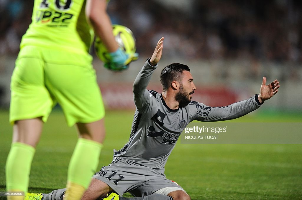 Marseille's French midfielder <a gi-track='captionPersonalityLinkClicked' href=/galleries/search?phrase=Romain+Alessandrini&family=editorial&specificpeople=9572619 ng-click='$event.stopPropagation()'>Romain Alessandrini</a> reacts during the French L1 football match between Girondins de Bordeaux (FCGB) and Marseille (OM) on April 12, 2015 at the Chaban-Delmas stadium in Bordeaux, southwestern France.
