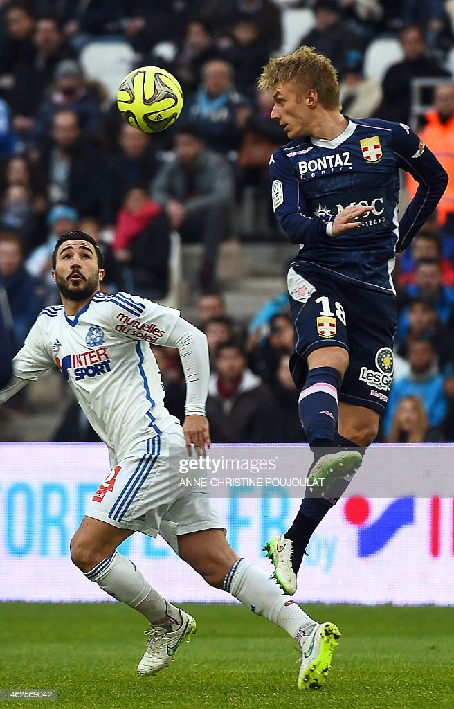Marseille's French midfielder <a gi-track='captionPersonalityLinkClicked' href=/galleries/search?phrase=Romain+Alessandrini&family=editorial&specificpeople=9572619 ng-click='$event.stopPropagation()'>Romain Alessandrini</a> (L) vies with Evian's Danish defender Daniel Wass (R) during the French L1 football match between Marseille and Evian Thonon Gaillard, on January 31, 2015 at the Velodrome stadium in Marseille, southern France. PHOTO / ANNE