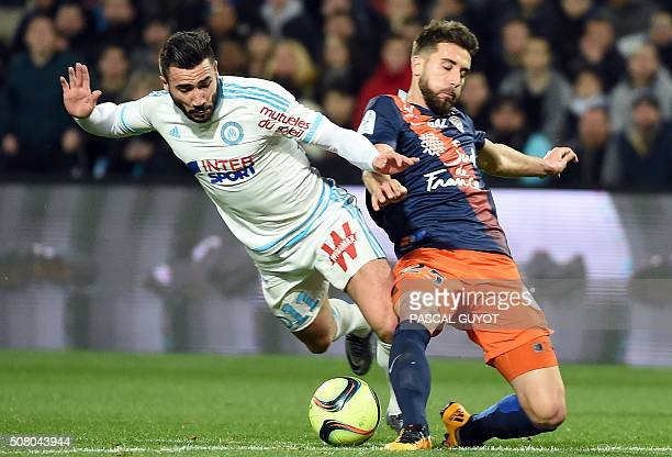 Marseille's French midfielder Romain Alessandrini vies with Montpellier's French defender Mathieu Deplagne during the French L1 football match...