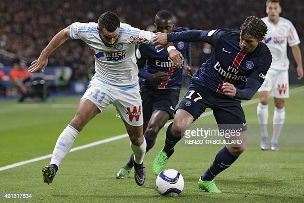 Marseille's French midfielder Romain Alessandrini vies with Paris SaintGermain's Brazilian defender Maxwell during the French L1 football match Paris...