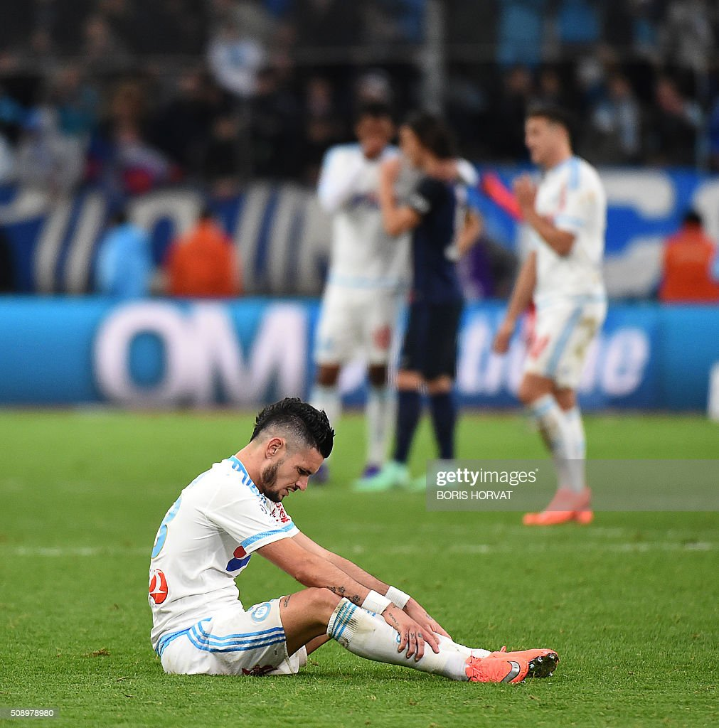 Marseille's french miedfielder Remy Cabella sits at the end of their French L1 football match Olympique of Marseille (OM) versus PSG at the Velodrome stadium in Marseille on Febuary 7, 2016. AFP PHOTO / BORIS HORVAT / AFP / BORIS HORVAT