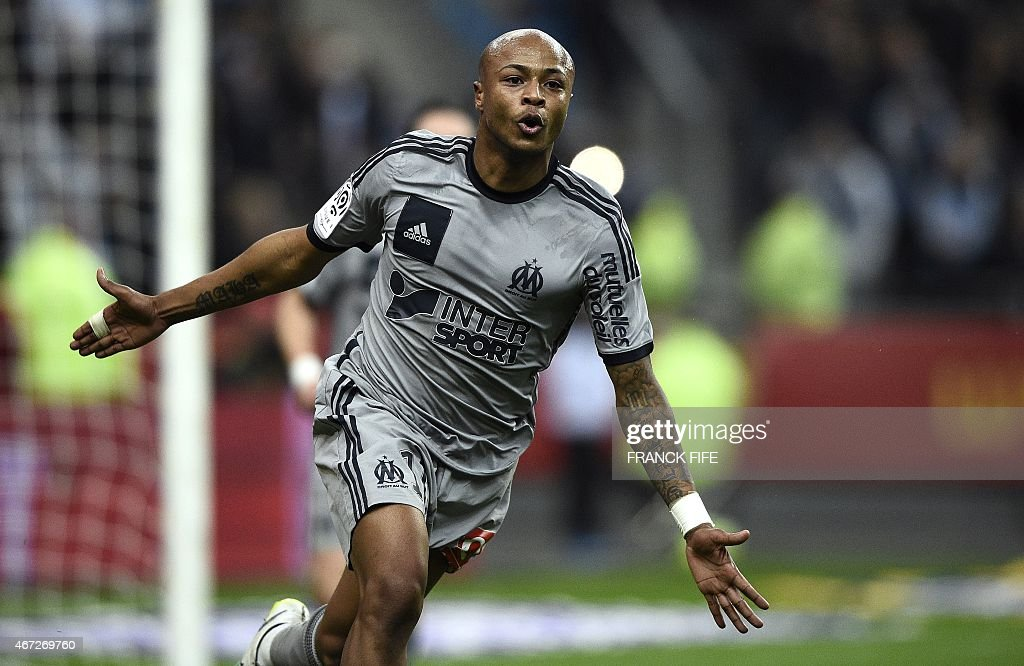 Marseille's Ghanaian forward Andre Ayew celebrates after scoring a goal during the French L1 football match between Lens and Marseille on March 22, 2014 at the Stade de France in Saint-Denis, north of Paris. AFP PHOTO / FRANCK FIFE
