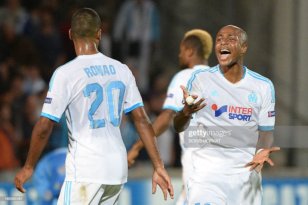 Marseille's Ghanaian forward Andre Ayew celebrates after scoring against Napoli on October 22, 2013 during a UEFA Champion's league Group F football match at the Velodrome stadium in the southern French city of Marseille.
