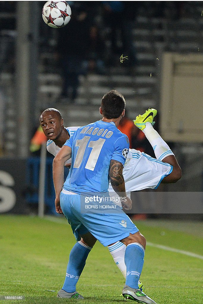 Marseille's Ghanaian forward Andre Ayew (L) fights for the ball with Napoli midfielder Christian Maggio (R) on October 22, 2013 during a UEFA Champion's league Group F football match at the Velodrome stadium in the southern French city of Marseille.