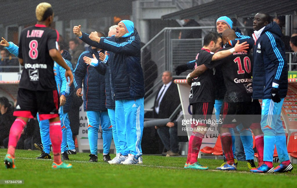 Marseille's Ghanaian forward Andre Ayew (2ndR ) is congratulated by Mathieu Valbuena and teammates standing next to his brother Jordan Ayew (L) and coach Elie Baup (2nd R) after scoring during the French L1 football match Brest vs Marseille at the Francis Le Ble stadium on December 2, 2012 in Brest, western France. AFP PHOTO / FRED TANNEAU