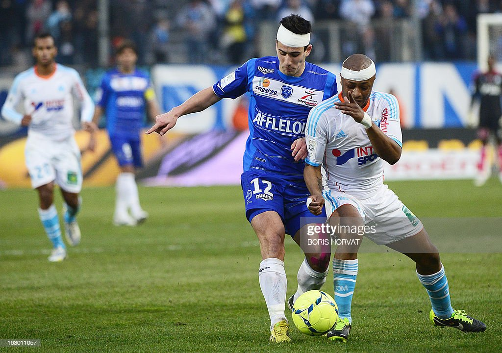 Marseille's Ghanaian forward Andre Ayew (R) vies for the ball for the ball with Troyes' French defender Maxime Colin (C) during the French L1 football match Marseille (OM) vs Troyes at the Velodrome stadium in Marseille, on March 3, 2013. AFP PHOTO / BORIS HORVAT