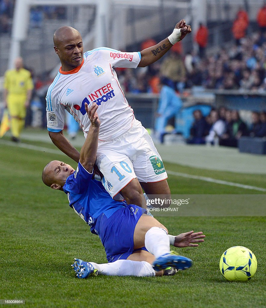 Marseille's Ghanaian forward Andre Ayew (R) vies for the ball with Troyes' Brasilian midfielder Xavier Thiago during the French L1 football match Olympique of Marseille vs Troyes at the Velodrome Stadium in Marseille, on March 3, 2013.