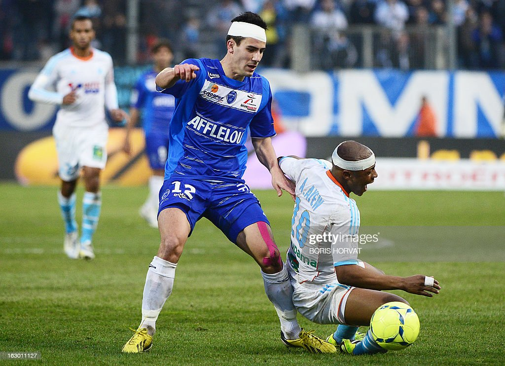 Marseille's Ghanaian forward Andre Ayew (R) vies for the ball with Troyes' French defender Maxime Colin (C) during the French L1 football match Marseille (OM) vs Troyes at the Velodrome stadium in Marseille on March 3, 2013.