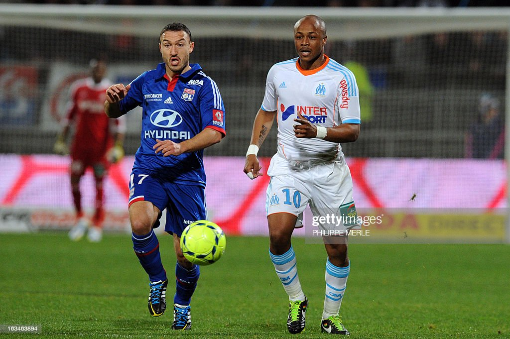 Marseille's Ghanaian forward Andre Ayew (R) vies with Lyon's Belgian midfielder Steed Malbranque during the French L1 football match Olympique Lyonnais (OL) vs Olympique de Marseille (OM) on March 10 , 2013 at the Gerland stadium in Lyon.
