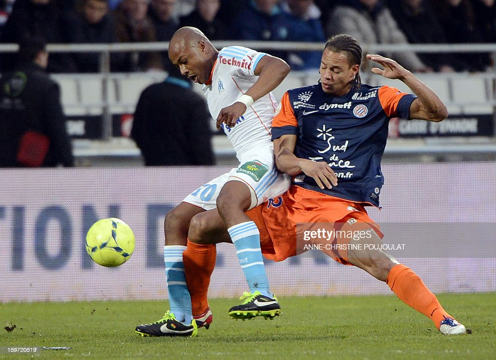 Marseille's Ghanaian forward Andre Ayew (L) vies with Montpellier's French defender Daniel Congre (R) during the French L1 football match Marseille (OM) vs Montpellier (MHSC) on January 19, 2013 at the Velodrome stadium in Marseille, southern France.