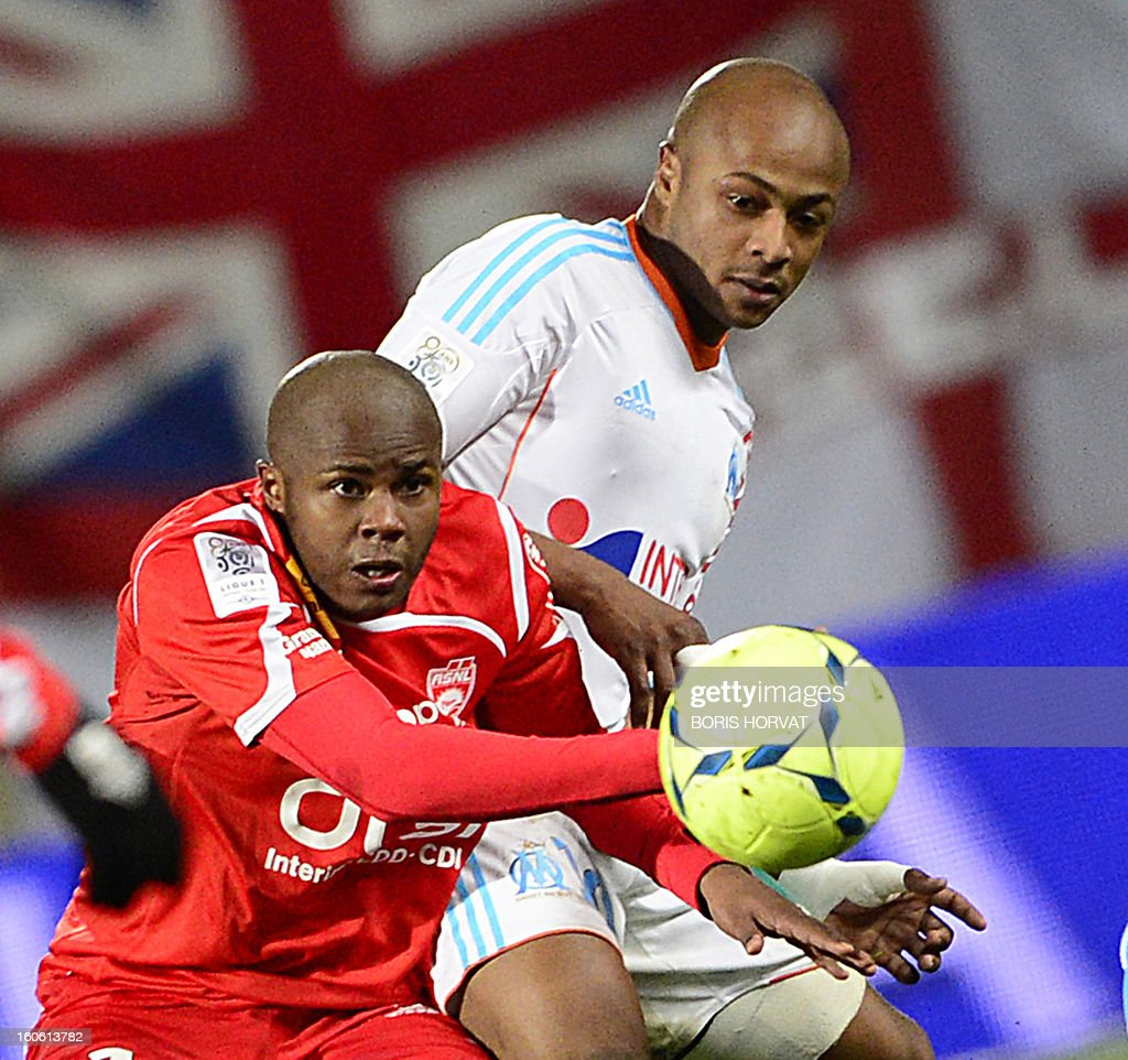 Marseille's Ghanaian forward Andre Ayew (R) vies with Nancy's French forward Djamel Bakar (L) during their French L1 football match Olympique of Marseille (OM) versus Nancy (ASNL) at the Velodrome stadium in Marseille on February 3, 2013. AFP PHOTO / BORIS HORVAT