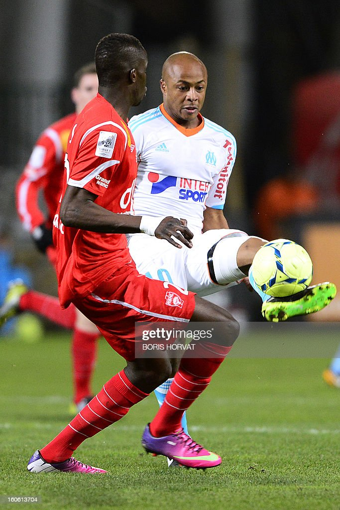 Marseille's Ghanaian forward Andre Ayew (R) vies with Nancy's French defender Salif Sane (L) during their French L1 football match Olympique of Marseille (OM) versus Nancy (ASNL) at the Velodrome stadium in Marseille, on February 03, 2013.