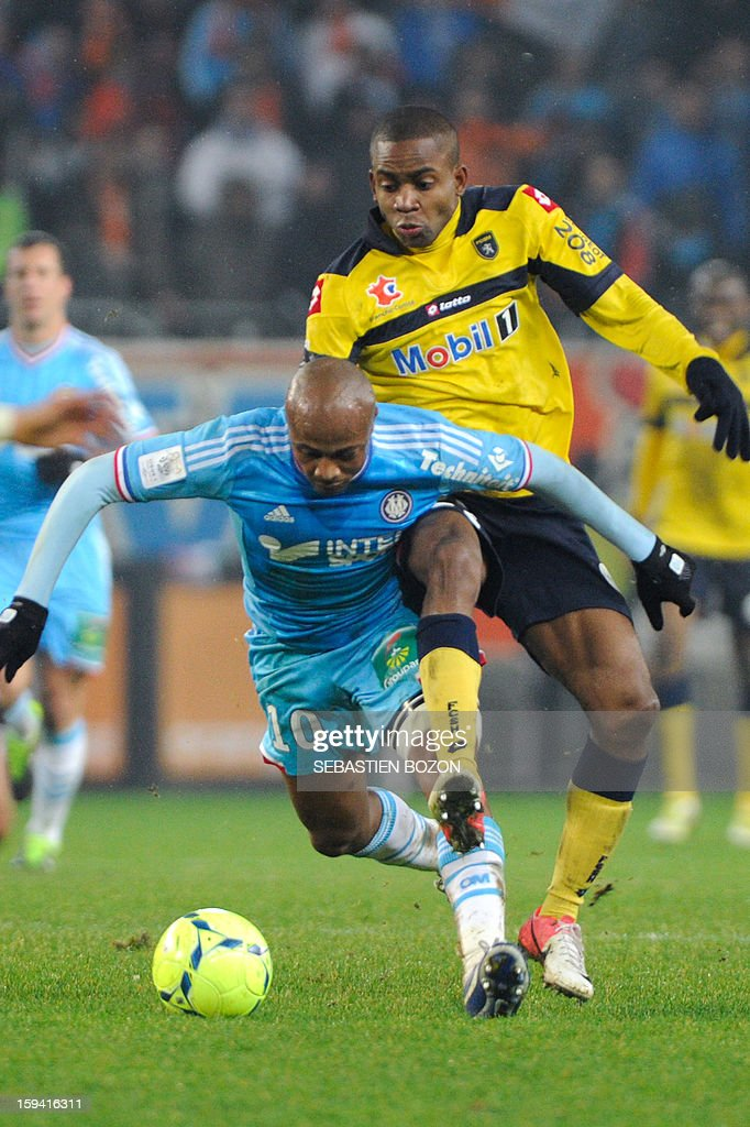 Marseille's Ghanaian forward Andre Ayew (L) vies with Sochaux' French forward Cedric Bakambu (R) during the French L1 football match Sochaux (FCSM) versus Marseille (OM) at the August Bonal Stadium in Montbeliard, on January 13, 2013.