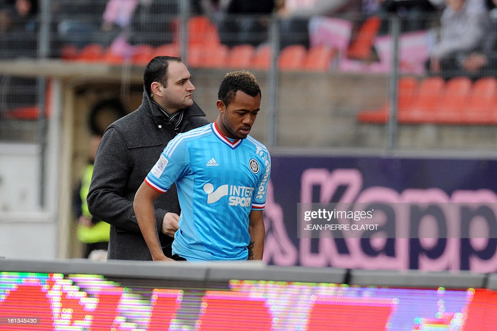 Marseille's Ghanaian forward Jordan Ayew leaves the pitch after receiving a red card during the French L1 football match Evian (ETGFC) vs Olympique de Marseille (OM) on February 10, 2013 at the city stadium Parc-des-sports in Annecy, eastern France.
