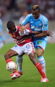 Marseille's Ghanaian forward Jordan Ayew vies with Reims' French midfielder Johan Ramare during the French L1 football match Reims vs Marseille on...