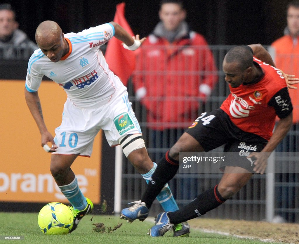 Marseille's Ghanaian midfielder Andre Ayew (L) vies with Rennes' French midfielder Axel Ngando (R) during their French L1 football match Stade Rennais FC vs Olympique de Marseille, on January 26, 2013 at the route-de-Lorient stadium in Rennes, western France.