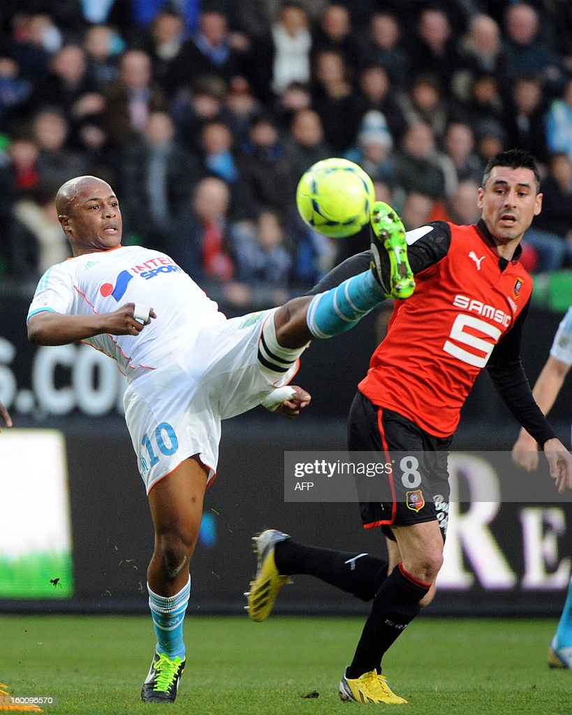Marseille's Ghanaian midfielder Andre Ayew (L) vies with Rennes' French midfielder Julien Feret (R) during the French L1 football match Stade Rennais FC vs Marseille, on January 26, 2013 at the route de Lorient stadium in Rennes, western France.