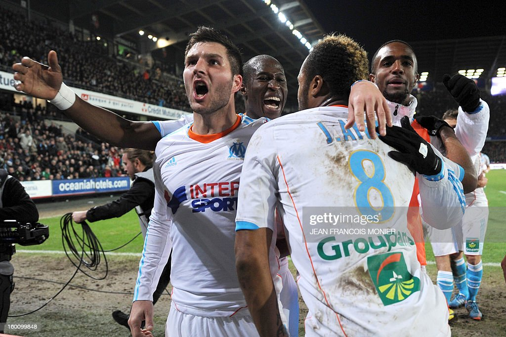 Marseille's Ghanaian midfielder Jordan Ayew (2R) is congratulated by his teammates French midfielder Morgan Amalfitan (L) and French defender Rod Fanni (C) after scoring during their French L1 football match Stade Rennais FC versus Marseille, on January 26, 2013 at the Route de Lorient Stadium in Rennes, western France. AFP PHOTO / JEAN FRANCOIS MONIER