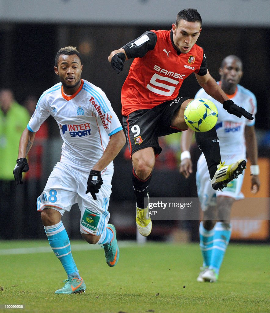 Marseille's Ghanaian midfielder Jordan Ayew (L) vies with Rennes' Turkish forward Mevlut Erding during the French L1 football match Stade Rennais FC vs. Marseille, on January 26, 2013 at the route-de-Lorient stadium in Rennes, western France.