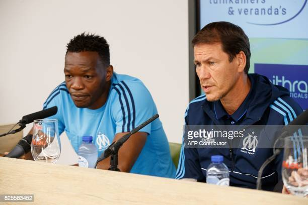 Marseille's head coach Rudi Garcia flanked by Marseille's goalkeeper Steve Mandanda speaks during a press conference of French club Olympic Marseille...