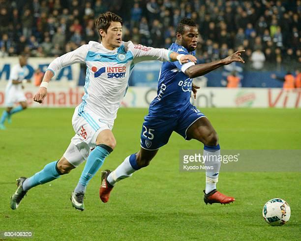 Marseille's Hiroki Sakai and Lassana Coulibaly of Bastia vie for the ball in the French Ligue 1 in Bastia on Dec 21 2016 Marseille won 21